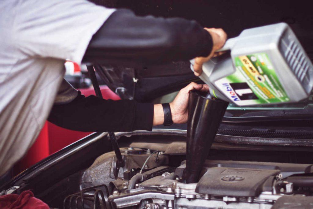 Filling oil car before road trip