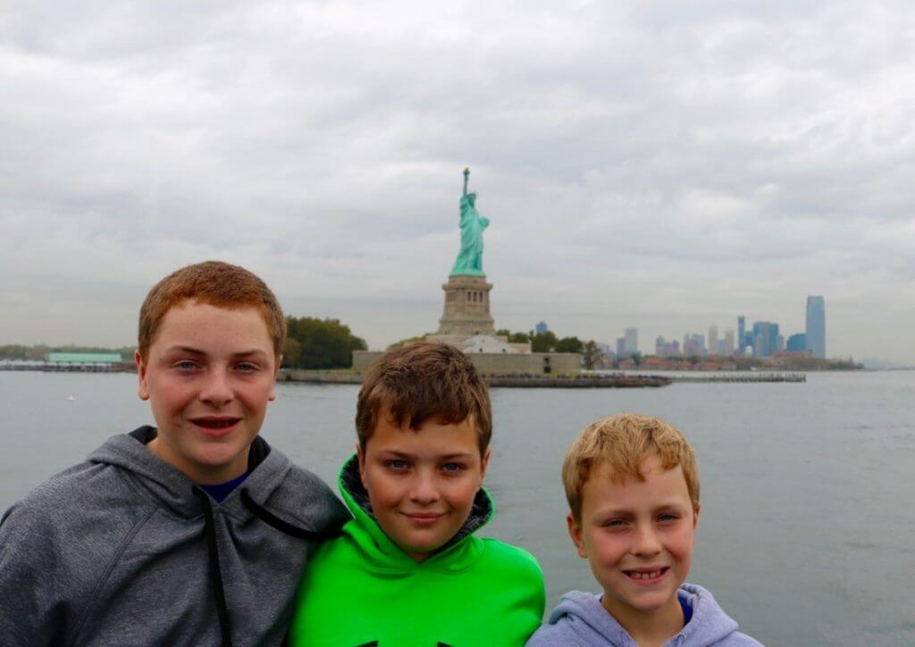 new york city weekend with kids statute of liberty-kids are a trip