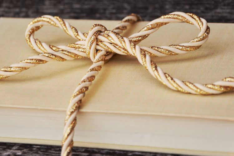 book wrapped with ribbon
