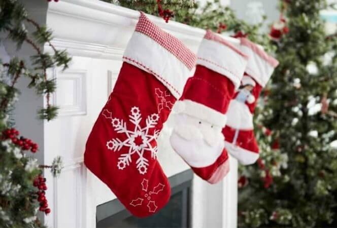 Holiday stockings hanging by chimney