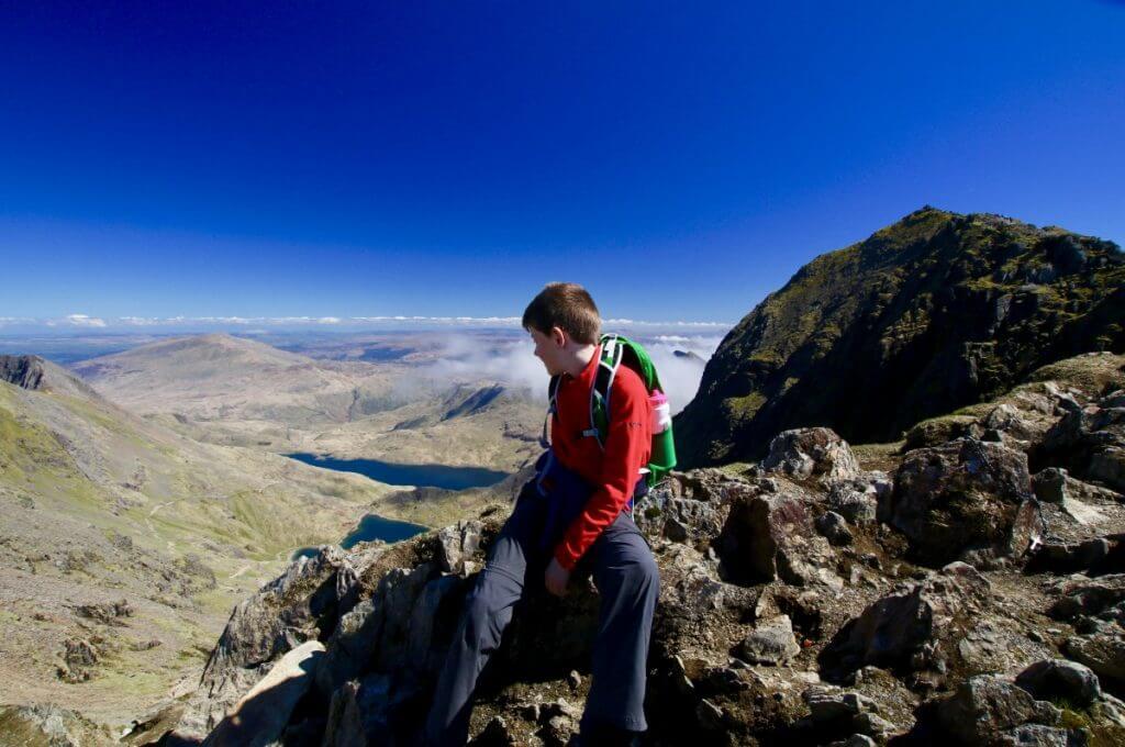 boy on mountain Snowdonia Wales