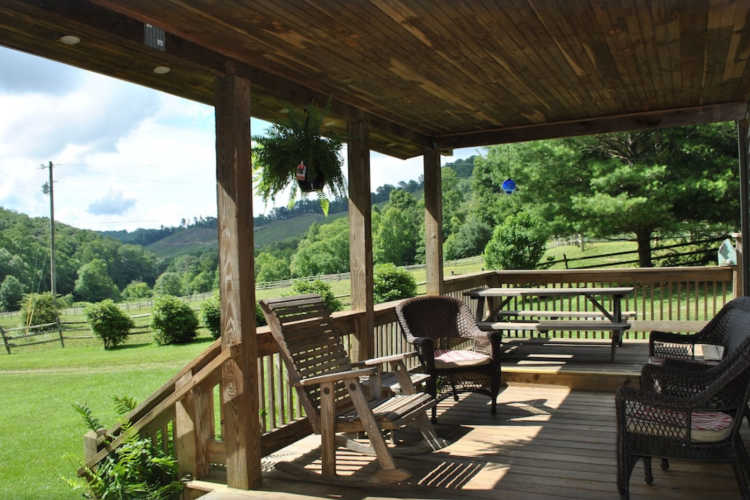 Front porch looking over yard and hill