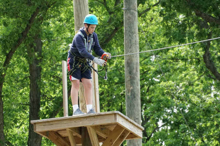 Ropes course adventure child on platform-Kids Are A Trip